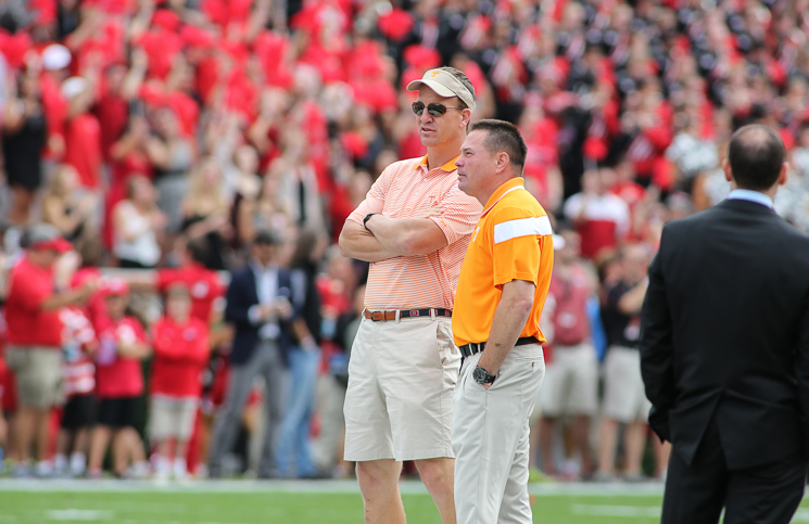 Butch Jones and Peyton Manning talk before the 2014 Georgia game